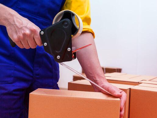 employee sealing a box